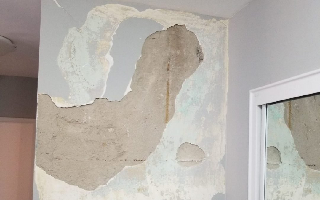 damaged old plaster wall showing different layers of plaster